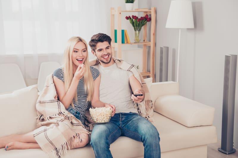 couple watching netflix together and enjoying
