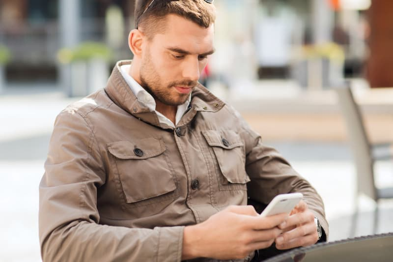 man texting and he is uninterested
