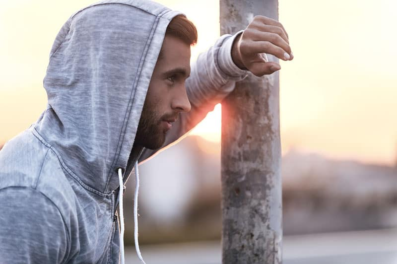 Man with a hoodie at a distance