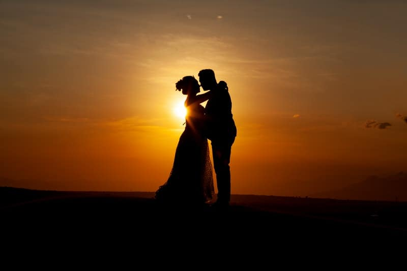 couple kissing during sunset