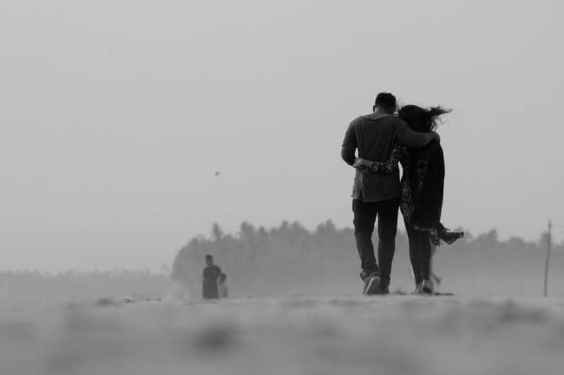 couple walking on ground