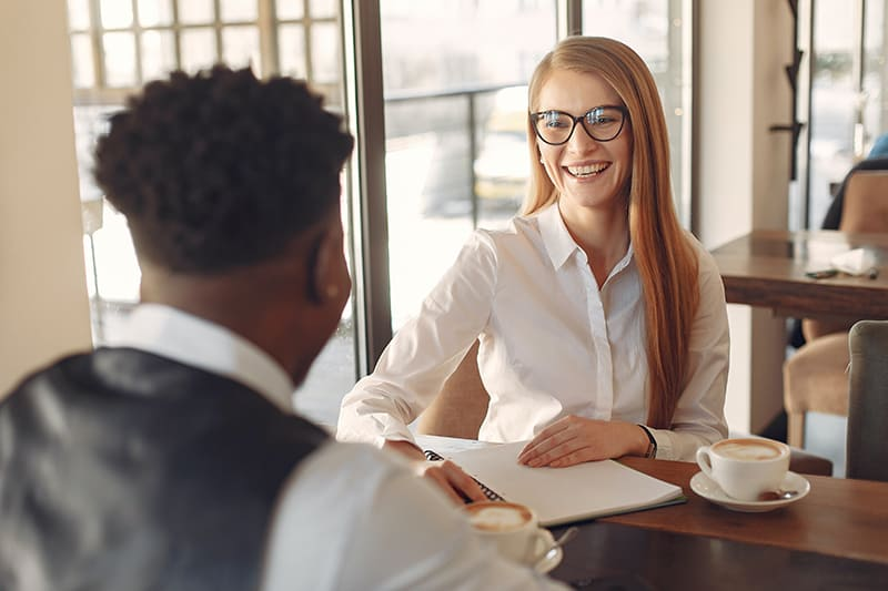 woman showing admiration to men while having a conversation