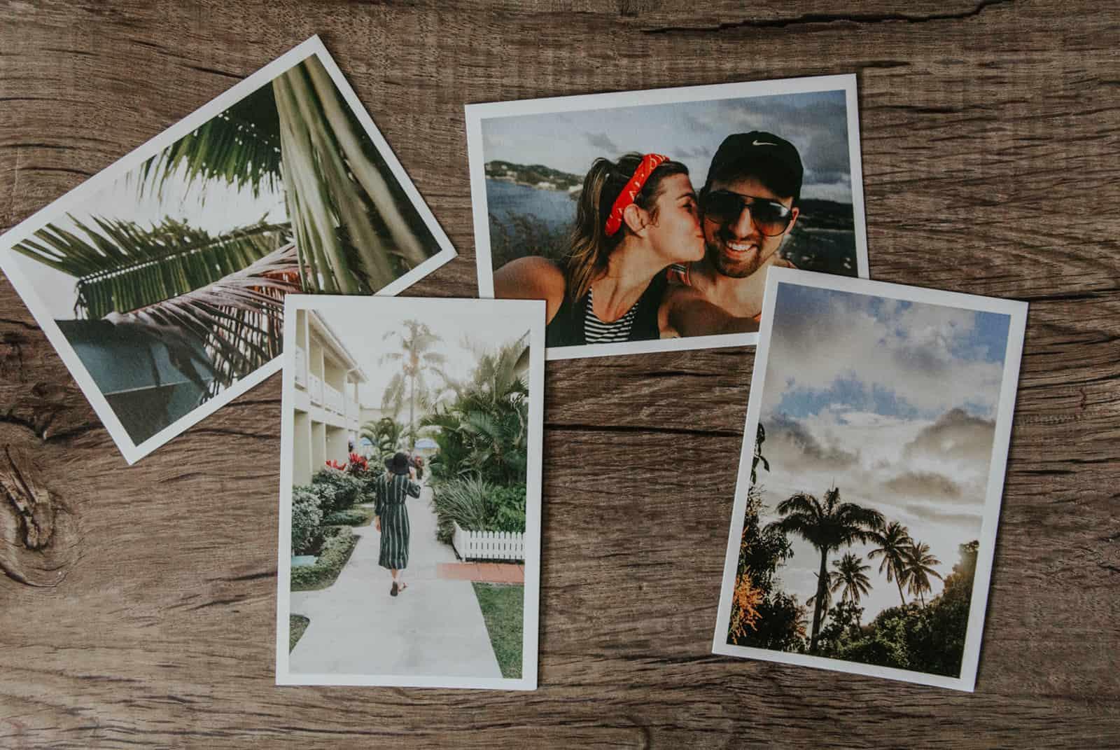 Fotos eines liebenden Paares auf einer Holzoberfläche