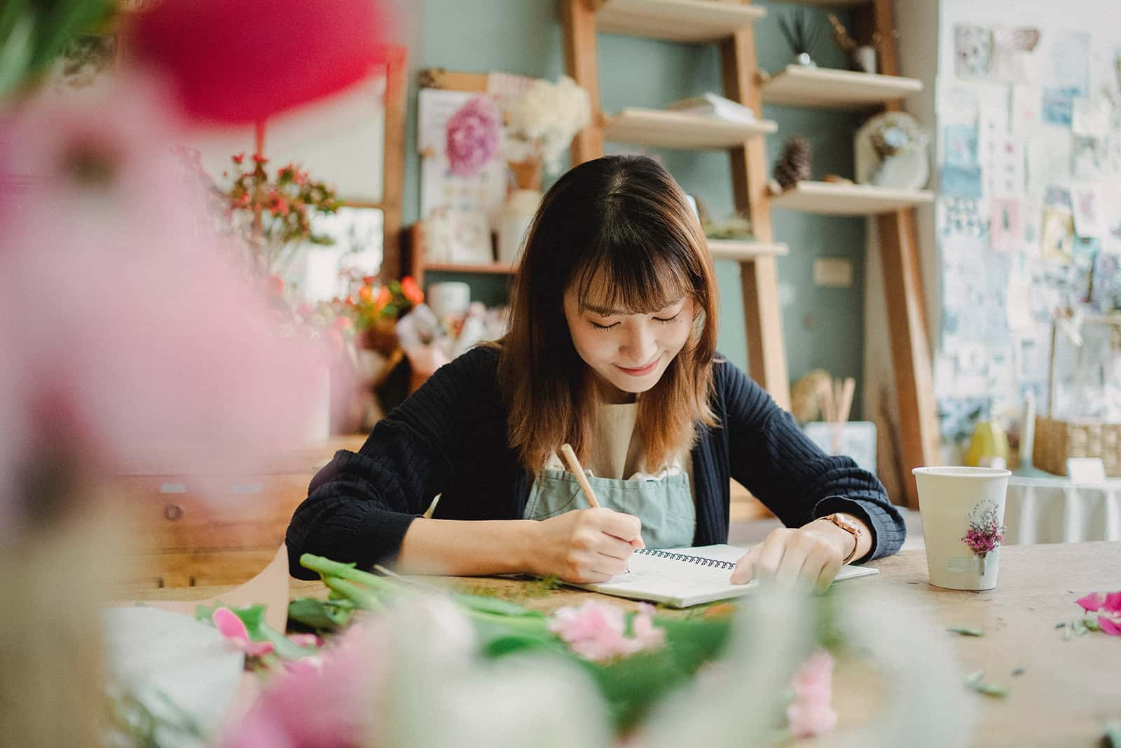 smiling woman writing letter